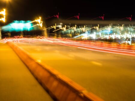Blur tail traffic lights on road.