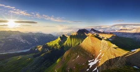 schweiz: Swiss Mountain Panorama at Sunset Stock Photo