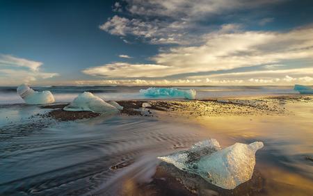 melting ice: Melting Icebergs on the Shore at Sunset