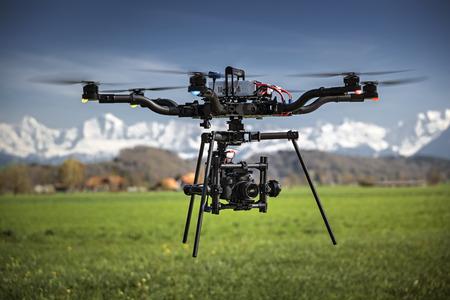 Big professional camera drone in mid-air on a film set Standard-Bild