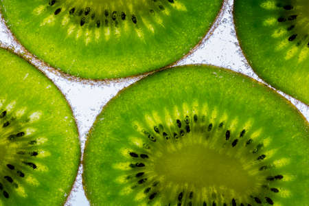 Slices of kiwi fruit with bubbles. Healthy food.