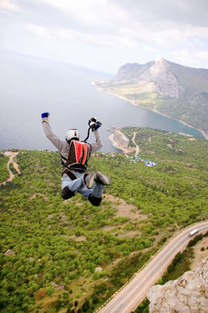 BASE jump off a cliff