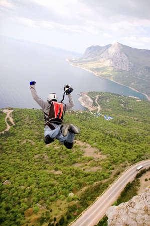 BASE jump off a cliff