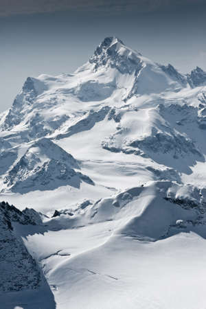 climbing mountain: Snow covered beautiful mountain peaks Stock Photo