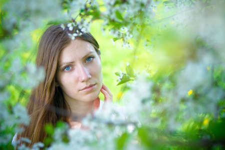 Beautiful girl with white flowers Stock Photo - 16336907