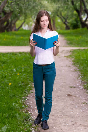 girl reading book in the park photo