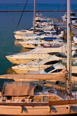 Row of anchored white yacht on the pier Stock Photo