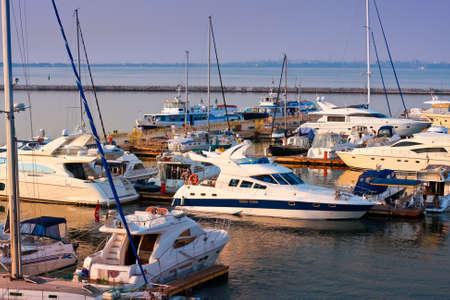 Anchored white yachts Stock Photo