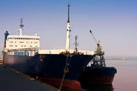 Anchored cargo ship in port