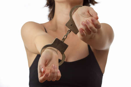 Young woman in handcuffs closeup