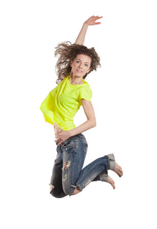 smiling young woman jumping with her hand up