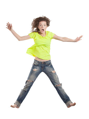 young woman jumping looking surprised photo