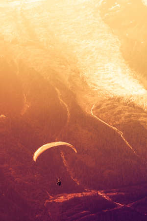 Sepia paraglide over Alps peaks