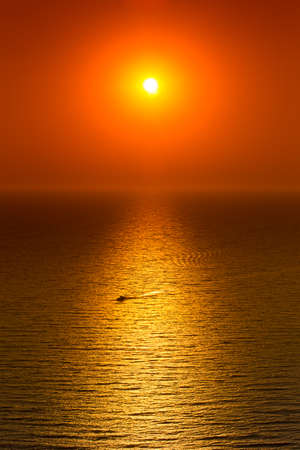 Red sunset over calm sea Stock Photo