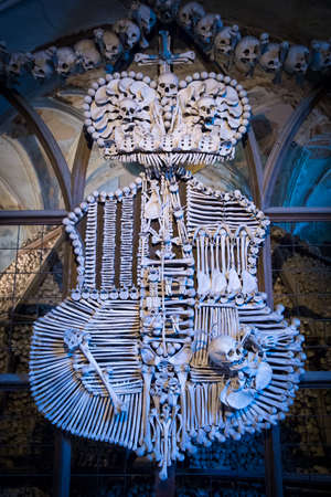 Ancient family emblem made from human skulls and bones in Sedlec Ossuary, Kutna Hora, Czech Republic Stock Photo