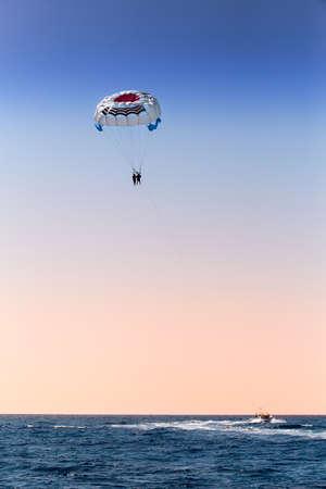 parasailing: parasailing over blue sea