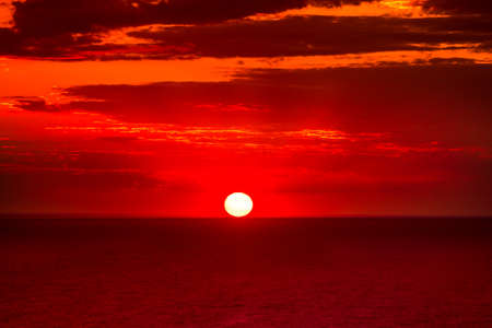over the sea: Red dramatic sunset over calm sea