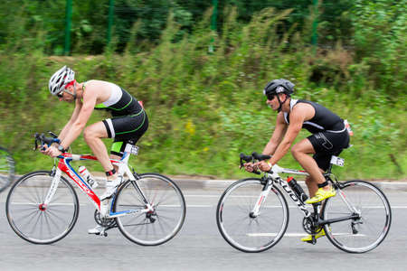 Two triathletes ride speed cycles during triathlon competition in Moscow