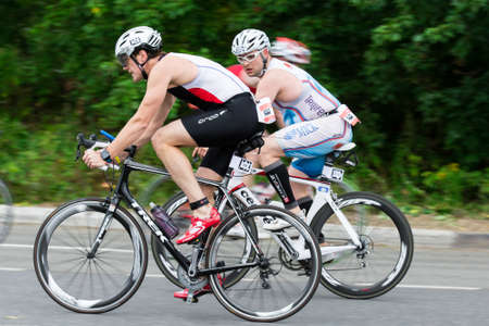 cycles: Triathletes ride speed cycles during triathlon competition in Moscow, Russia