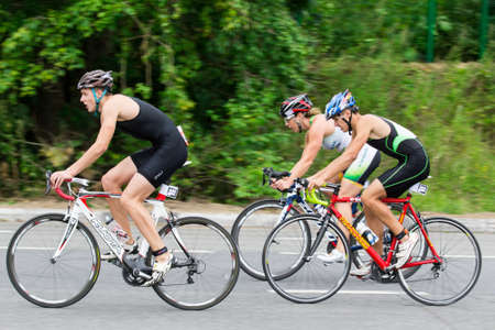 Triathletes ride speed cycles during triathlon competition in Moscow, Russia