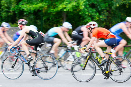 Triathletes ride speed cycles back and forth during triathlon competition in Moscow, Russia