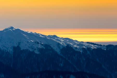 Orange sunset over mountains Stock Photo