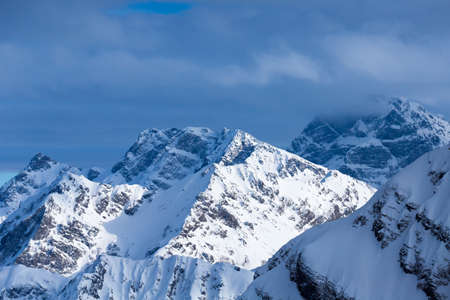 top view to Caucasian mountains peaks covered by snow