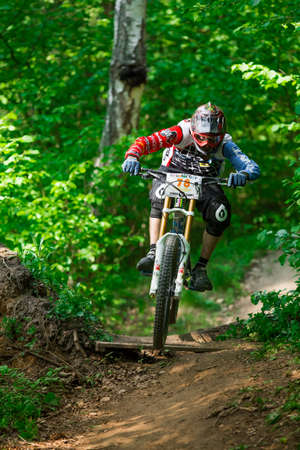 reactor: Russia, Obninsk - May 18, 2013: Mountainbiker rides through green forest at REACTOR CUP contest, Obninsk, Russia Editorial