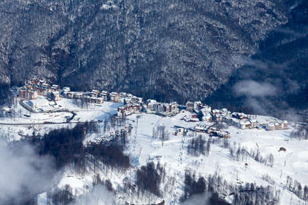 top view to winter Rosa Hutor ski resort and Caucasian mountains Stock Photo
