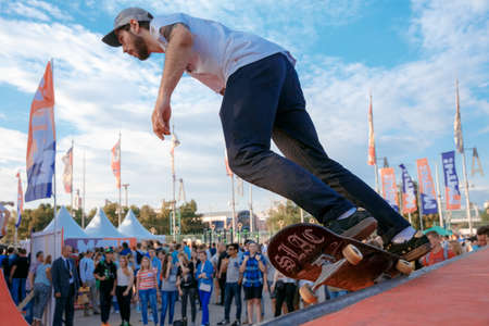 Russia, Moscow, July 23, 2016: Skateboarder makes ollie stunt at Moscow City Games contest, Luzhniki, Moscow, Russia Editorial