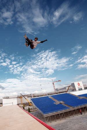 Russia, Moscow, August 18, 2016: Skateboarder making a stunt in quarter pipe ramp at Russian X Challenge 2016 contest