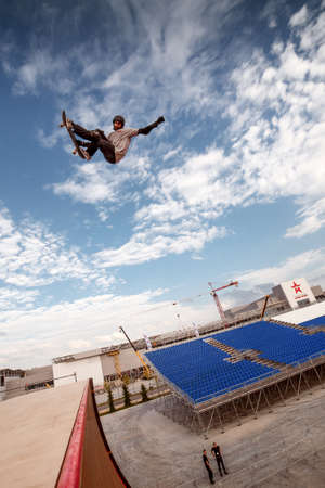 Russia, Moscow, August 18, 2016: Skateboarder making a stunt in quarter pipe ramp at Russian X Challenge 2016 contest Redakční