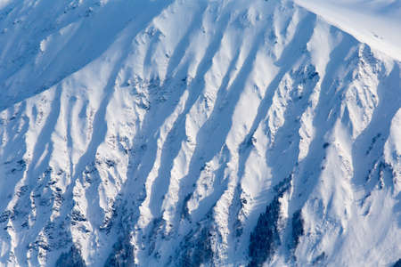 Severe mountains ridge covered by snow Stock Photo