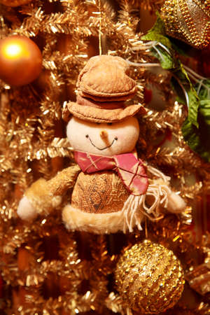 Christmas gold garland with snowman. Art decoration
