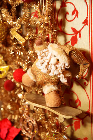 Christmas gold garland with Santa on skate. Art decoration