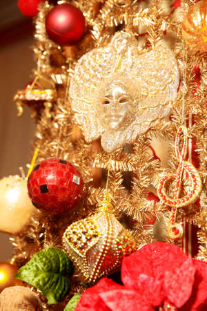 Christmas gold garland with full face mask. Art decoration