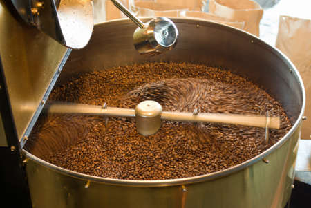 the process of roasting coffee in a large roasting pan mechanical photo