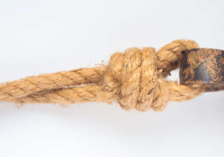 hemp rope with a knot isolated on white background photo