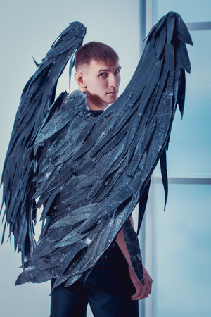 the man with the black wings of a fallen angel