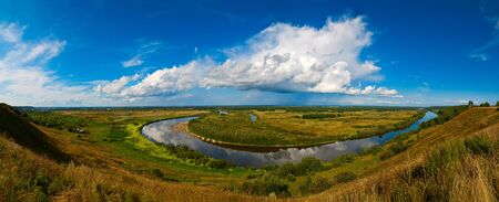A wide panorama of the Russian landscape. Klyazma river under the clouds
