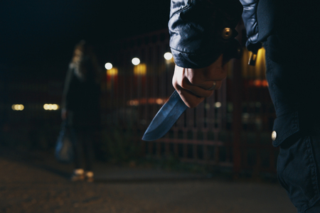 crime concepts robbery concepts a robber aimed his sharp knife at a woman to rob her valuable things