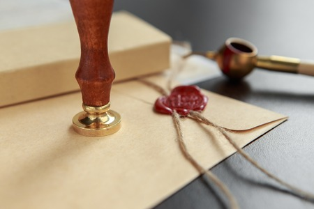 Notarial wax seal on tied scrolled documents, closeup Stock Photo