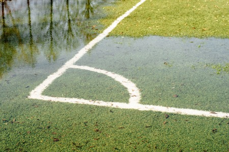A flooded soccer field after heavy rain
