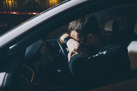 Business man in the car,Alcoholism,Drunk man,Dangerous on road,Blurry portrait