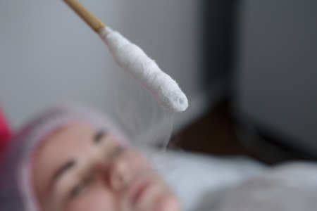 Face cryomassage close up. Liquid nitrogen therapy. Zdjęcie Seryjne