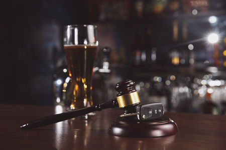 Car keys are in a glass of beer.