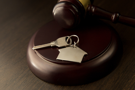 Gavel wooden and house for home buying or selling of bidding or lawyer of home real estate and auction concept. Stock Photo