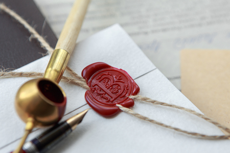 Old notarial wax seal on tied scroll, closeup