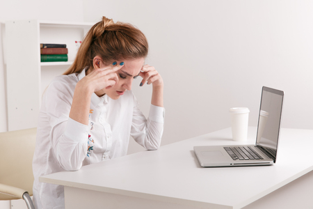 Stressedbusinesswoman having headache at work concept, frustrated dizzy chinese woman touching temple tired of aching head or chronic fatigue in office