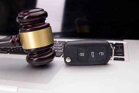 Judge gavel on laptop keyboard. Symbol of law, justice and online auction